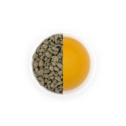 Ginseng Ren shen oolong kopje thee en theebladeren in witte theekop.
